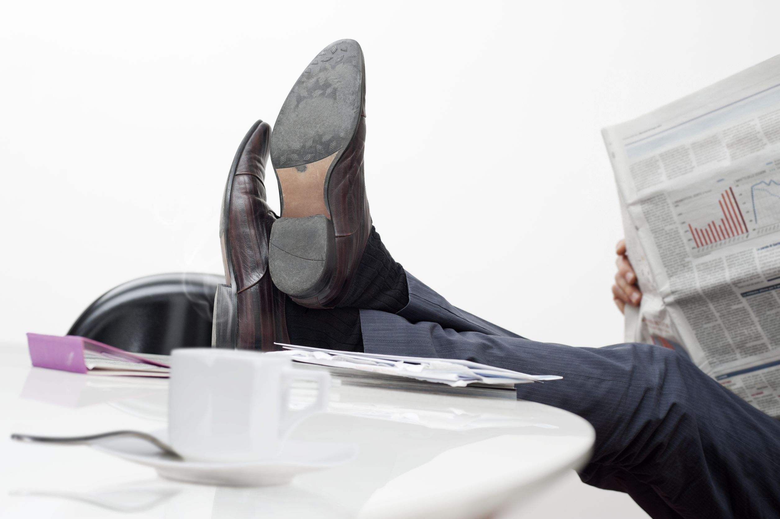 14699606 - manager with feet on desk and cup of coffee
