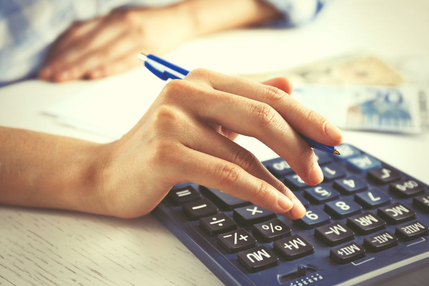 47947427 - accounting concept.analyzing finance report with calculator