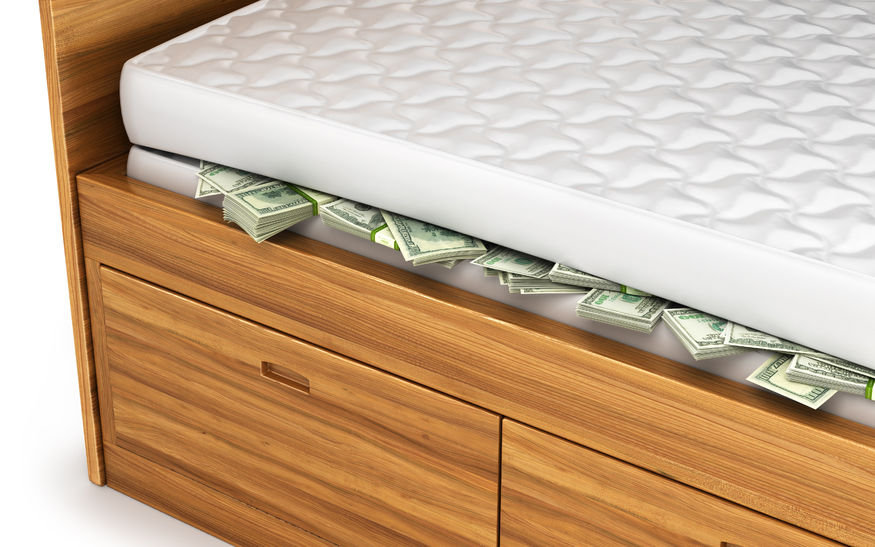 53058536 - money, dollars hidden under a white mattress.
