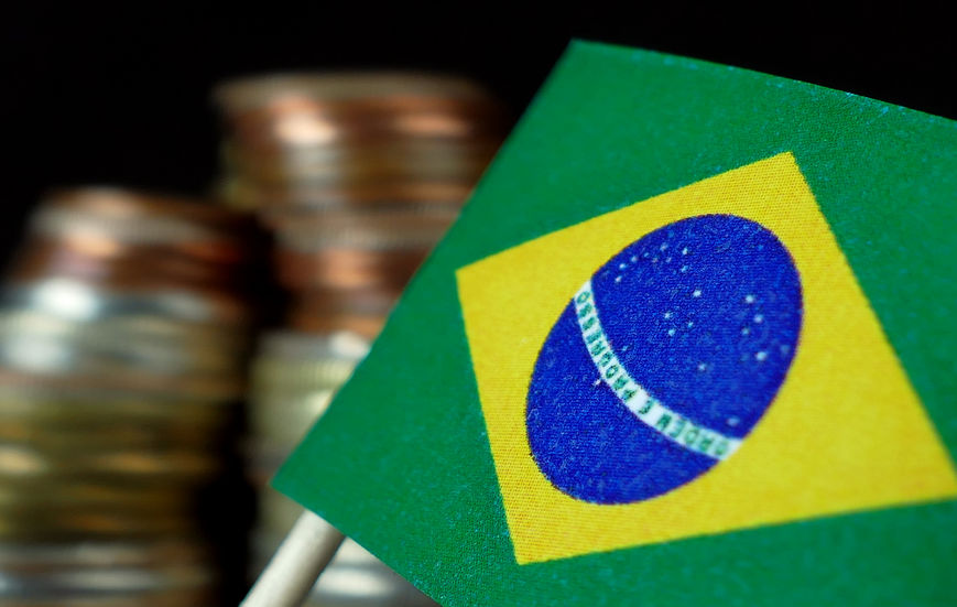 73255402 - brazilian flag waving with stack of money coins macro
